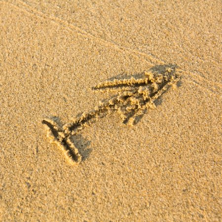 Photo for Zodiac sign Sagittarius, drawn on the facture beach sand. (zodiac signs series) - Royalty Free Image