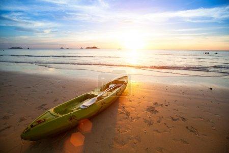 Kayak at the tropical beach at beautiful sunset.