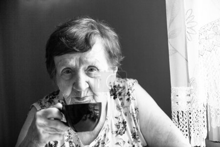 Woman is drinking tea