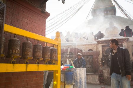 Unidentified man sell cement for donations for repairs near stupa Boudhanath