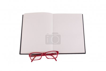 Red glasses placed on notebook