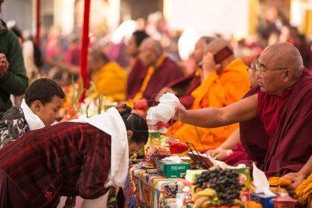 Buddhist monks near stupa Boudhanath in Nepal