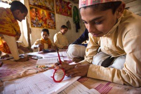 Children doing homework in Nepal school