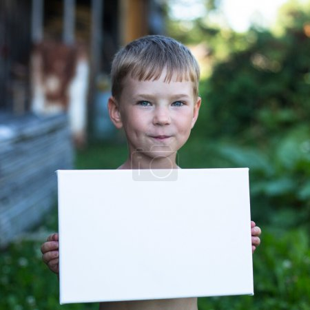 Boy holding clean sheet paper