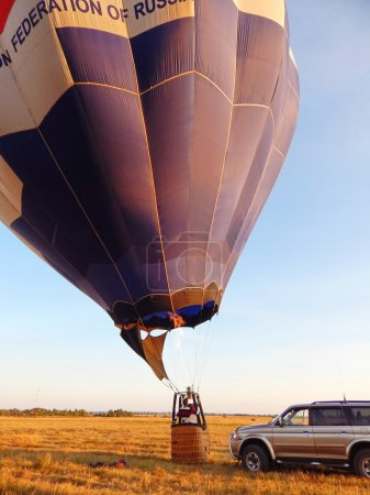 Getting the air balloon ready for the trip. The first flight. Active life. Summer ballooning. Russia. July, 2014.