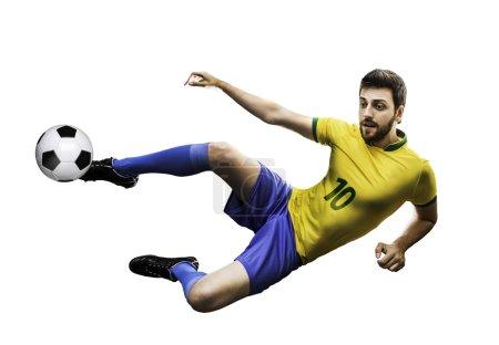 Brazilian soccer player in the jump, kicks the ball