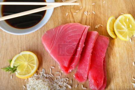 Fresh tuna with rice and lemon on the table
