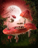 Fairy garden with red mushrooms