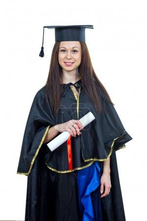 Photo pour Diplômée portant une robe et une truelle - isolée sur du blanc - image libre de droit
