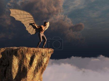 Photo pour Un homme ailé va sauter dans le vide - image libre de droit