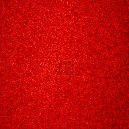 Photo pour Tapis rouge texture de fond avec quelques fibres en elle - image libre de droit