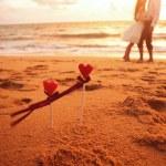 Loving couple on the beach...