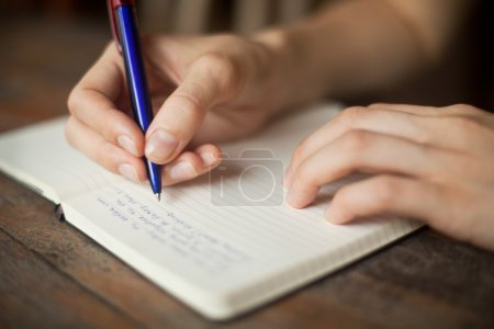 Photo for Abstract hands writing on the paper - Royalty Free Image