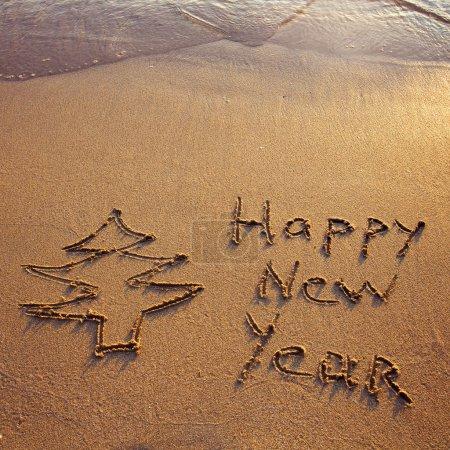 Photo pour Nouvel an salutations sur le sable - image libre de droit