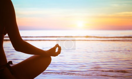 Photo for Serenity and yoga practicing at sunset, meditation - Royalty Free Image