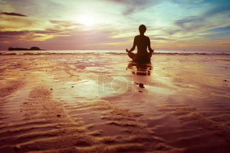 Photo for Sport and fitness, silhouette of woman meditating on the beach - Royalty Free Image