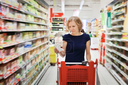 Photo for Woman in supermarket, shopping - Royalty Free Image