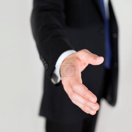 Businessman offering for handshake