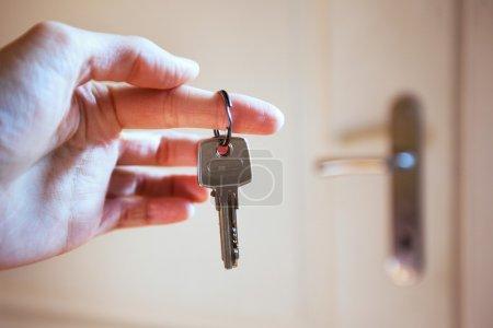 Hand holds a key