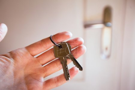 Photo for Rent a flat, keys in the hand - Royalty Free Image