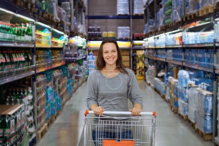 Photo for Woman shopping at the supermarket - Royalty Free Image