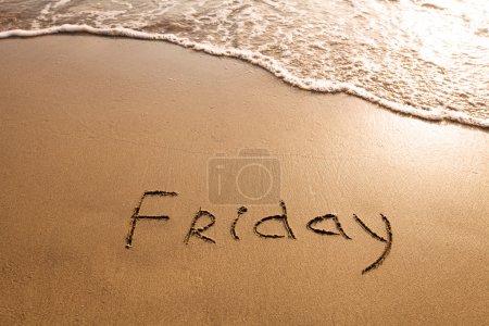 Friday written on the sand