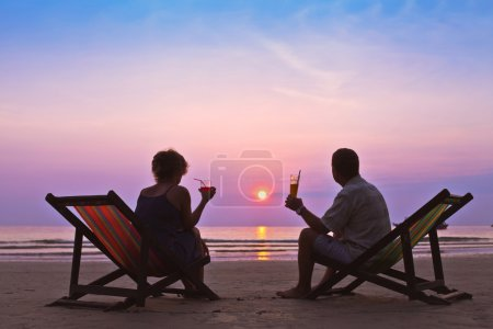 Photo for Couple on the beach on sunset - Royalty Free Image