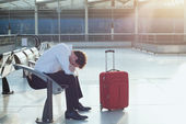 Man waiting for departure of his flight