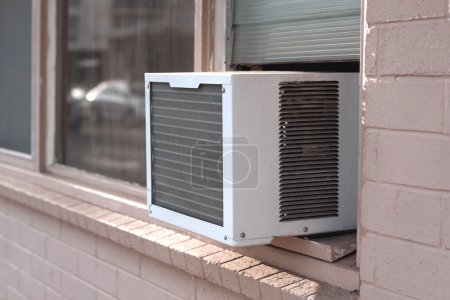 Photo for An air conditioning unit in a window, viewed from exterior - Royalty Free Image