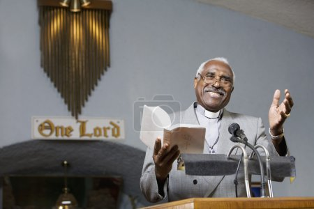African American Reverend preaching in church