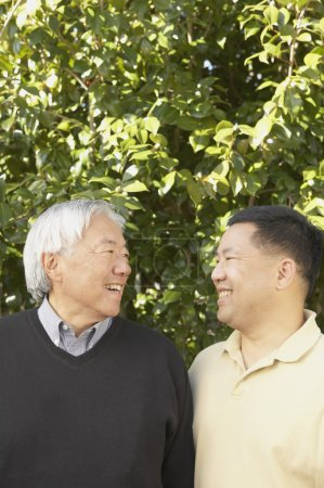 Senior Asian father with grown son
