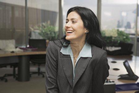 Portrait of Hispanic businesswoman laughing