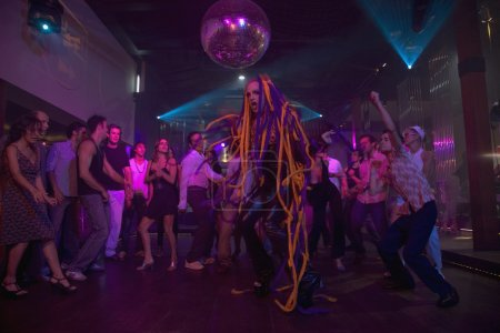 Man with hair extensions dancing at nightclub