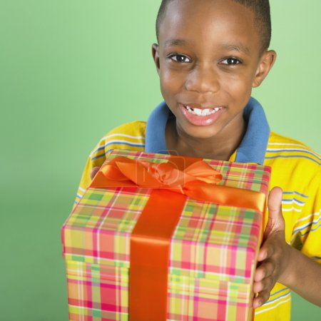 Portrait of African boy holding gift