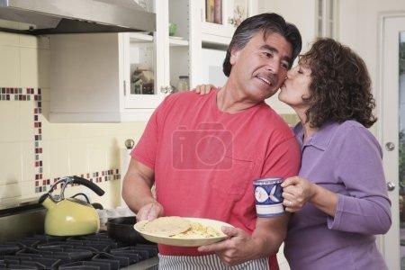 Senior Hispanic couple in kitchen