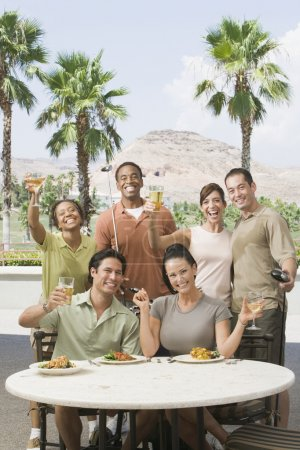 Multi-ethnic friends drinking at golf clubhouse