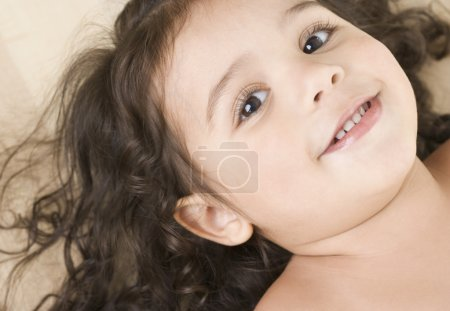 Close up portrait of little girl smiling