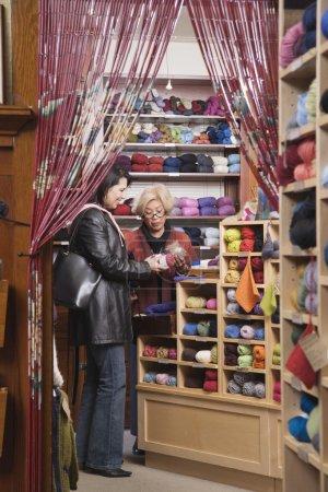 Two women in yarn shop