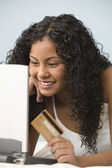 Teen girl shopping online with credit card