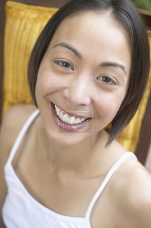 Close up of woman smiling in chair