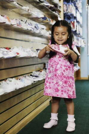Young Hispanic girl at shoe store