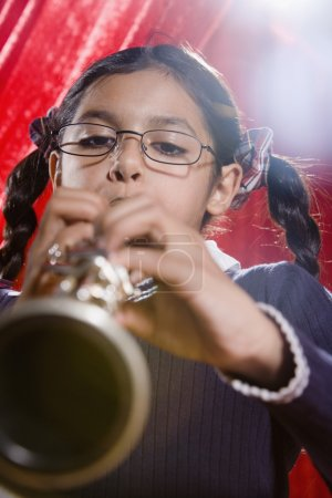 Hispanic girl playing clarinet