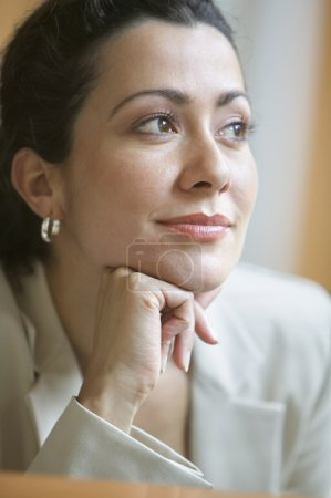 Businesswoman thinking with hand on chin