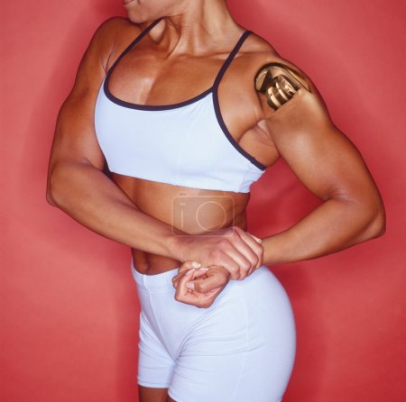 Female body builder with bionic shoulder