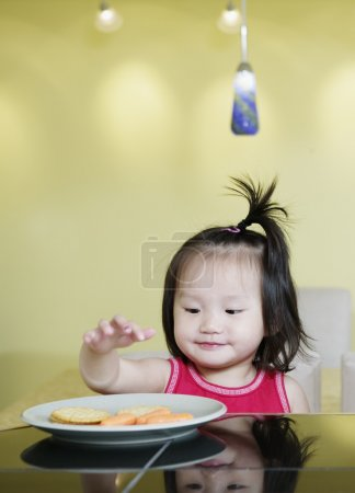 Young girl eating snack