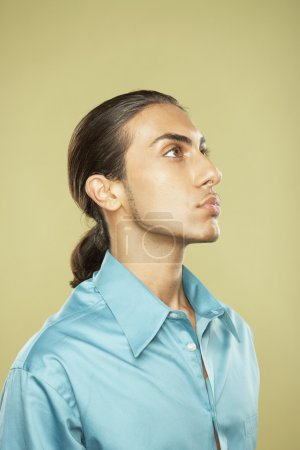Studio shot of Middle Eastern man looking up