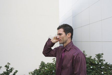 Side view portrait of businessman talking on cell phone
