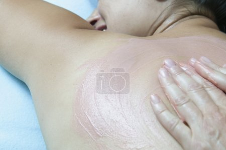 Close up of woman receiving back massage