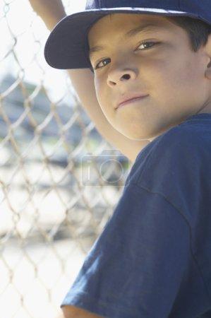 Portrait of boy at baseball game
