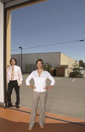 Businesswoman standing in a garage